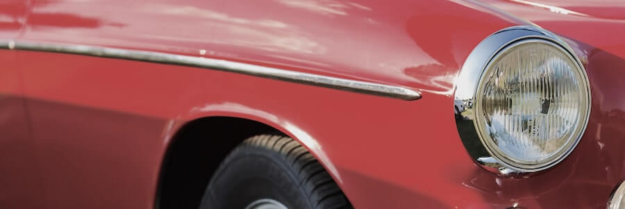Close Up Fragment Of The Red Vintage Car Headlight