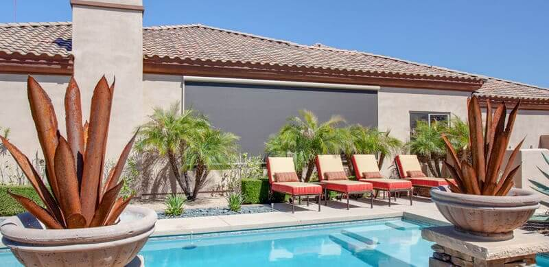 home with motorized retractable sun screens