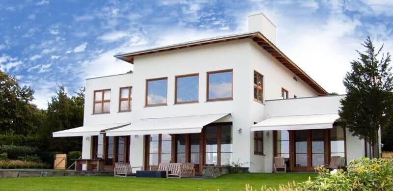 home with white retractable awnings