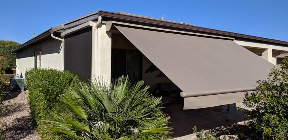 house with large gray retractable awning